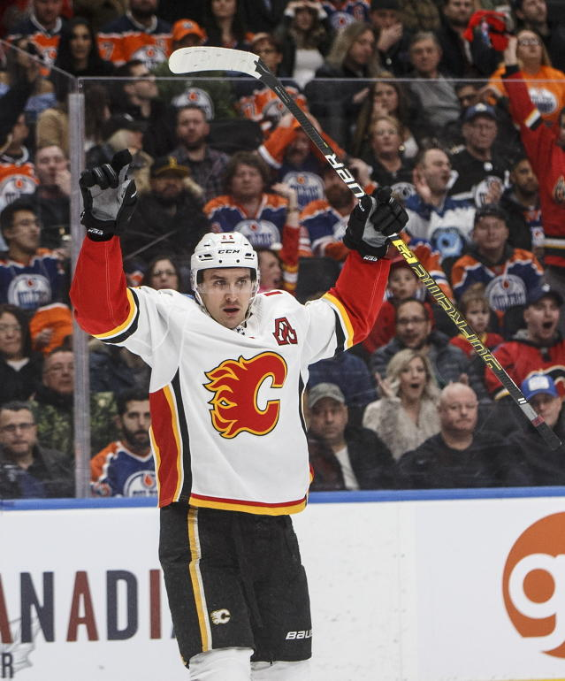 Calgary Flames' Mikael Backlund celebrates a goal against the Edmonton Oilers during the third period of an NHL hockey game in Edmonton, Alberta, Saturday, Jan. 19, 2019. (Jason Franson/The Canadian Press via AP)