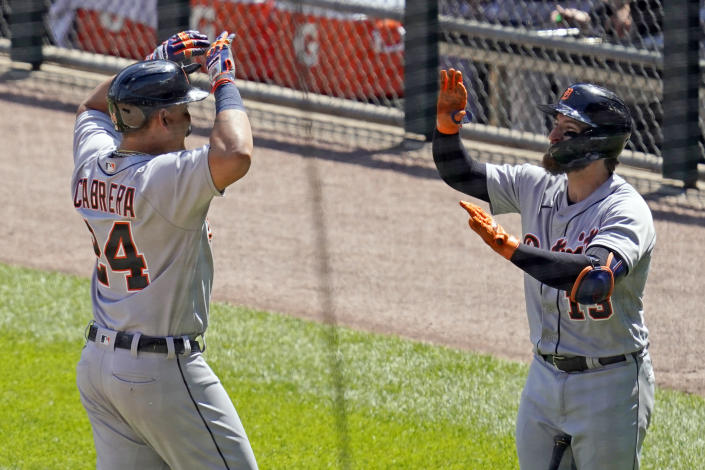 Detroit Tigers' Miguel Cabrera, left, celebrates with Eric Haase after hitting a solo home run during the sixth inning of a baseball game against the Chicago White Sox in Chicago, Saturday, June 5, 2021. (AP Photo/Nam Y. Huh)