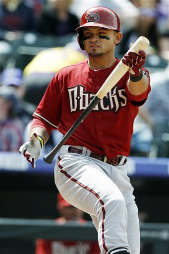 Arizona Diamondbacks' Gerardo Parra reacts after fouling off a pitch against the Colorado Rockies in the first inning of a baseball game in Denver, Sunday, April 21, 2013. (AP Photo/David Zalubowski)