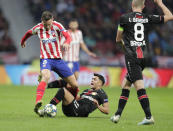 Atletico Madrid's Saul, left, fights for the ball against Leverkusen's Nadiem Amiri during the Champions League Group D soccer match between Atletico Madrid and Bayer Leverkusen at Wanda Metropolitano stadium in Madrid, Spain, Tuesday, Oct. 22, 2019. (AP Photo/Bernat Armangue)