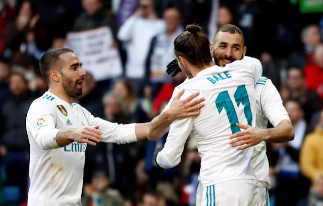 Soccer Football - La Liga Santander - Real Madrid vs Deportivo Alaves - Santiago Bernabeu, Madrid, Spain - February 24, 2018 Real Madrid's Gareth Bale celebrates scoring their second goal with Real Madrid's Karim Benzema REUTERS/Juan Medina