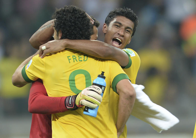 Brazil's Julio Cesar, Fred and Paulinho, from left, celebrate winning 2-1 after the soccer Confederations Cup semifinal match between Brazil and Uruguay at the Mineirao stadium in Belo Horizonte, Brazil, Wednesday, June 26, 2013. (AP Photo/Eugenio Savio)