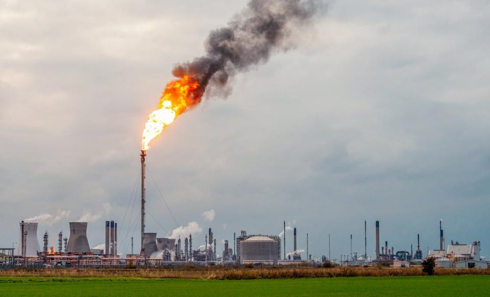 <p>Flames and smoke rising from a flare stack at Grangemouth oil refinery and petrochemical plant in Scotland</p> (Getty Images)