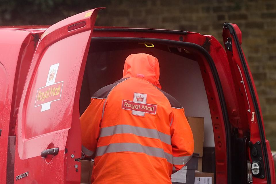 A Royal Mail postal worker preparers to deliver the mail at his van in London. According to Royal Mail, some areas of London have seen a reduced service as postal workers being off sick or self-isolating due to the Covid-19 pandemic. (Photo by Steve Taylor / SOPA Images/Sipa USA)