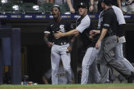 Chicago White Sox's Tim Anderson is held back by teammates as he yells at an umpire during the eighth inning of the team's baseball game against the Milwaukee Brewers on Friday, July 23, 2021, in Milwaukee. (AP Photo/Aaron Gash)