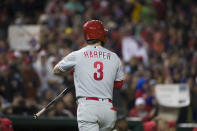 Philadelphia Phillies' Bryce Harper walks to the dugout after striking out in the first inning of a baseball game against the Washington Nationals at Nationals Park, Tuesday, April 2, 2019, in Washington. (AP Photo/Alex Brandon)