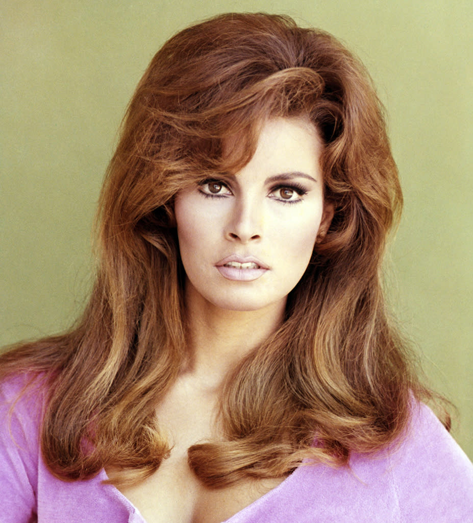 "<p>The phrase ""The higher the hair, the closer to God"" could easily refer to <a href=""https://www.yahoo.com/entertainment/raquel-welch-remembers-burt-reynolds-185017081.html"" data-ylk=""slk:Raquel Welch;outcm:mb_qualified_link;_E:mb_qualified_link;ct:story;"" class=""link rapid-noclick-resp yahoo-link"">Raquel Welch</a>. The Bolivian bombshell became a sex symbol after appearing in <i>One Million Years B.C.</i> in an infamous fur bikini, with tresses that reached new heights, a chic smoky eye, and nude <a href=""https://www.yahoo.com/lifestyle/tagged/lipstick"" data-ylk=""slk:lip"" class=""link rapid-noclick-resp"">lip</a> that would cement her sultry status for decades to come. Looking to take your hair to new heights? Shop these <a href=""https://www.yahoo.com/lifestyle/four-hair-care-routines-boost-213206058.html"" data-ylk=""slk:volumizing products;outcm:mb_qualified_link;_E:mb_qualified_link;ct:story;"" class=""link rapid-noclick-resp yahoo-link"">volumizing products</a>. (Photo: Getty Images) </p>"