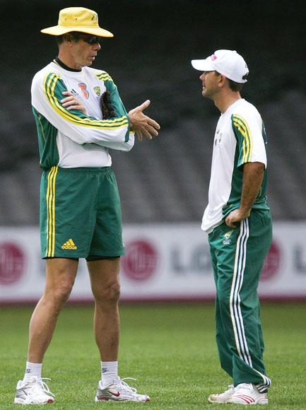 Coach of Australia John Buchanan talks with captain Ricky Ponting during training at Telstra Dome on October 3, 2005 in Melbourne, Australia.  (Photo by Hamish Blair/Getty Images) *** Local Caption *** John Buchanan;Ricky Ponting
