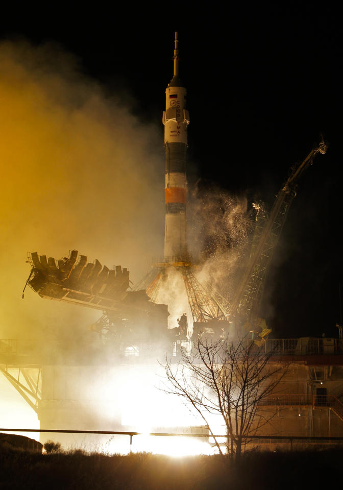 The Soyuz-FG rocket booster with Soyuz TMA-08M space ship carrying a new crew to the International Space Station, ISS, blasts off at the Russian leased Baikonur cosmodrome, Kazakhstan, Friday, March 29, 2013. The Russian rocket carries Russian cosmonauts Alexander Misurkin, Pavel Vinogradov and U.S. astronaut Christopher Cassidy. (AP Photo/Dmitry Lovetsky)