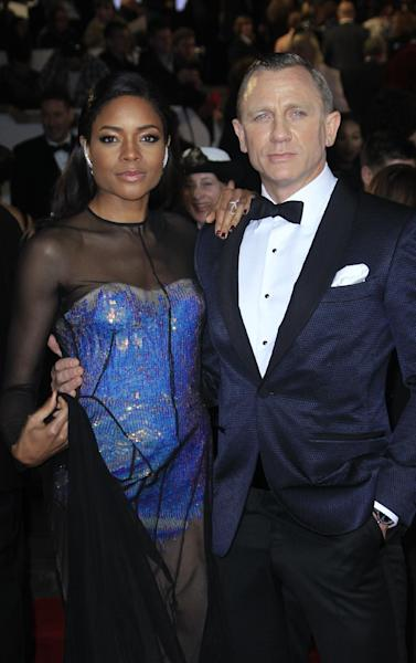 """Naomie Harris, left, and Daniel Craig arrive at the world premiere of """"Skyfall"""" at the Royal Albert Hall on Tuesday, Oct. 23, 2012 in London. (Photo by Joel Ryan/Invision/AP)"""