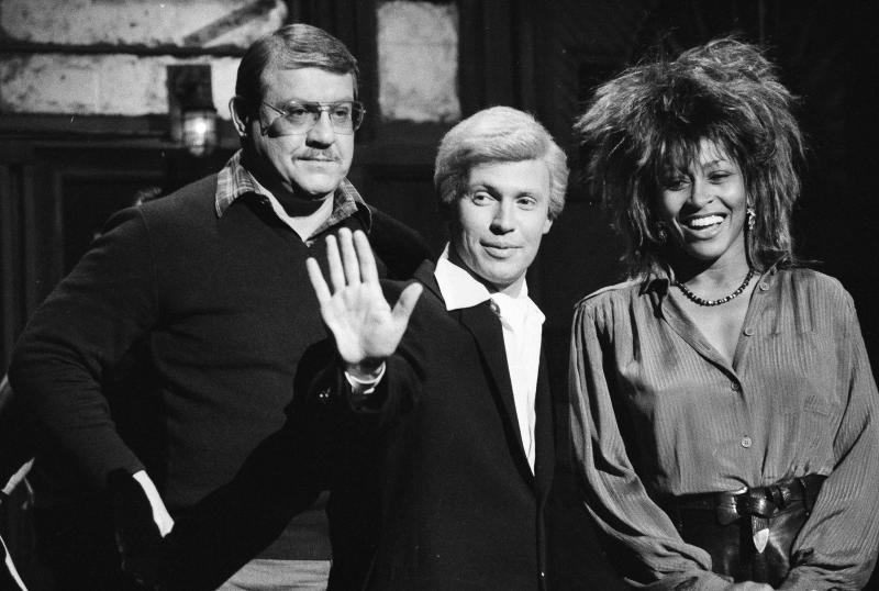 """FILE - In this Jan. 31, 1985, file photo, """"Saturday Night Live"""" actor Billy Crystal, center, in character as """"Fernando,"""" is flanked by host Alex Karras, left, and musical guest Tina Turner during a rehearsal in New York. Karras is taking on the role of lead plaintiff: He and his wife, Susan Clark, are two of 119 people who filed suit Thursday, April 12, 2012, in U.S. District Court in Philadelphia, the latest complaint brought against the NFL by ex-players who say the league didn't do enough to protect them from head injuries. (AP Photo/Marty Lederhandler, File)"""