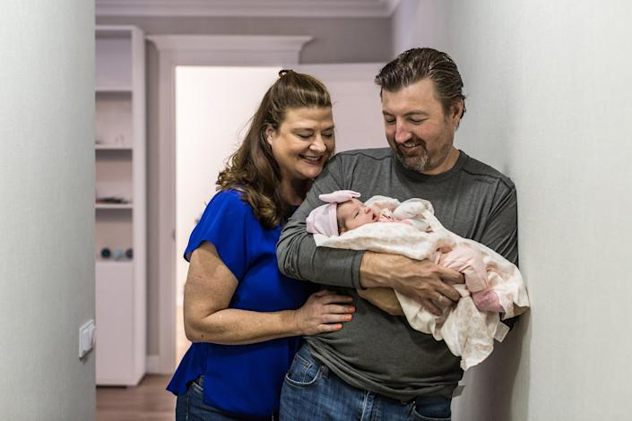 Image: Darlene Straub, 45, and Chris Straub, 43, a couple from Texas, hold their newborn baby, Sophia, born via surrogacy, in a rented apartment in  (Oksana Parafeniuk / for NBC News)