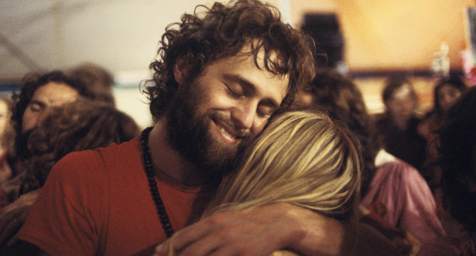Two cult members embrace. Source: Getty Images