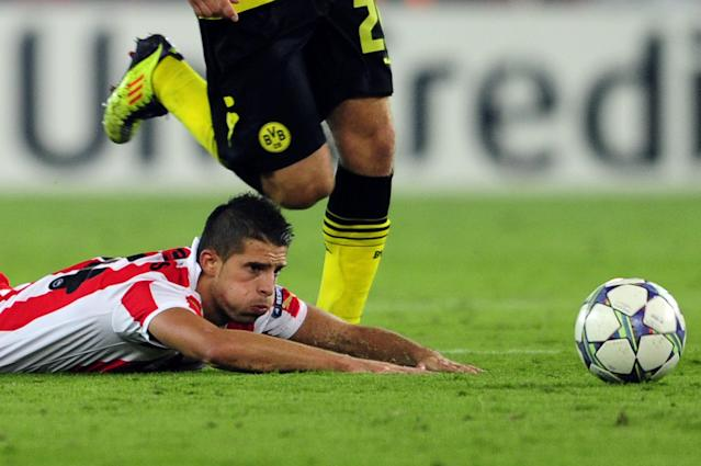 Olympiakos' Kevin Mirallas reacts during his group F Champions League football match against Borussia Dortmund in Athens on 19 October, 2011. AFP PHOTO / ARIS MESSINIS (Photo credit should read ARIS MESSINIS/AFP/Getty Images)