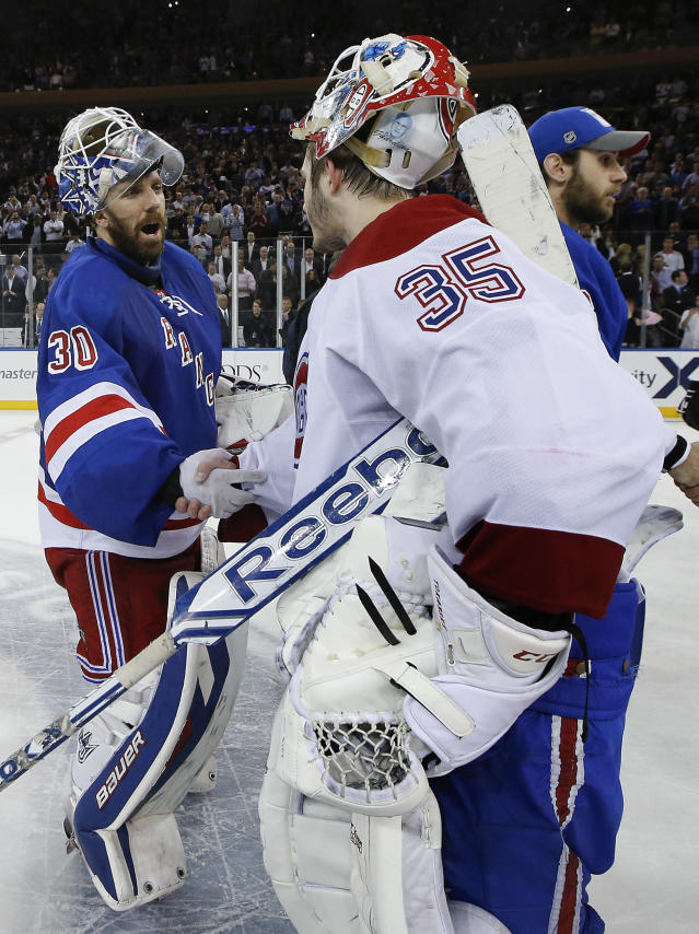New York Rangers goalie Henrik Lundqvist (30) greets Montreal Canadiens goalie Dustin Tokarski (35) after the Rangers beat the Montreal Canadiens 1-0 in Game 6 of the NHL hockey Stanley Cup playoffs Eastern Conference finals, Thursday, May 29, 2014, in New York. (AP Photo/Kathy Willens)