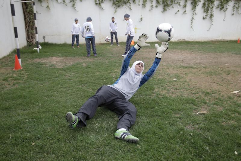 FILE - In this May 21, 2012 photo, Mawada Chaballout, a 27-year-old American member of a Saudi female soccer team practices at a secret location in Riyadh, Saudi Arabia. Saudi Arabia's official press agency says the Education Ministry has allowed private female schools to hold sports activities within the Islamic Sharia laws. SPA said Saturday, May 4, 2013 that the ministry issued directives ordering private female schools to provide appropriate places and equipment for such activities, adhere to wearing decent dress and that Saudi women teachers should be given priority in supervising these activities.(AP Photo/Hassan Ammar, File)