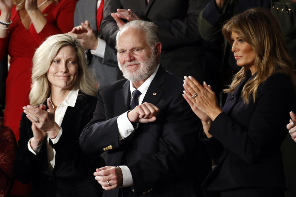 FILE - In this Feb. 4, 2020 file photo, Rush Limbaugh reacts as first Lady Melania Trump, and his wife Kathryn, applaud, as President Donald Trump delivers his State of the Union address to a joint session of Congress on Capitol Hill in Washington. Limbaugh, the talk radio host who became the voice of American conservatism, has died. (AP Photo/Patrick Semansky, File)