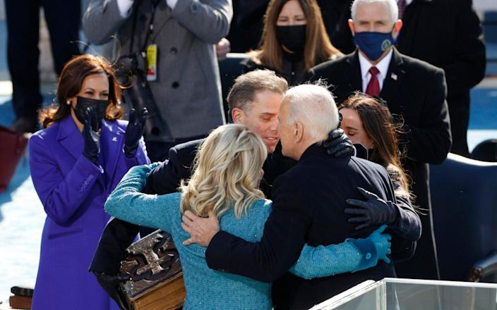 Biden hugs his family after becoming president - REUTERS