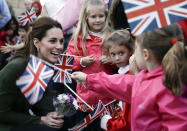 FILE - In this Wednesday, Dec. 5, 2018 file photo, Kate, the Duchess of Cambridge, greets family members of personnel at the Akrotiri Royal Air Force base, near the south coastal city of Limassol, Cyprus. Prince Philip was the longest serving royal consort in British history. In Britain, the husband or wife of the monarch is known as consort, a position that carries immense prestige but has no constitutional role. The wife of King George VI, who outlived him by 50 years, was loved as the Queen Mother. Prince Charles' wife, Camilla, has worked to emerge from the shadow of his immensely popular first wife, Diana. (AP Photo/Matt Dunham, Pool, File)