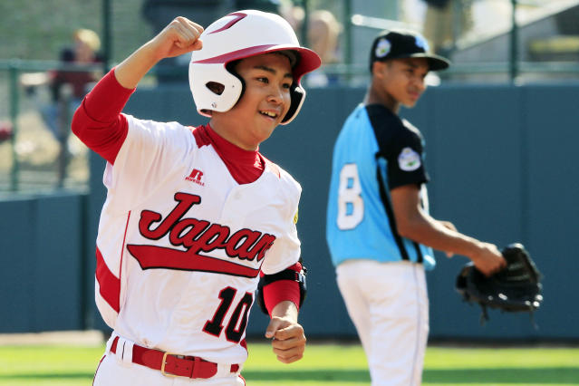 Tokyo, Japan's Noriatsu Osaka (10) rounds the bases past Goodlettsville, Tenn., second baseman Lorenzo Butler (8) after hitting a walk-off, two-run home run in the fifth inning of the Little League World Series championship baseball game in South Williamsport, Pa., Sunday, Aug. 26, 2012. Tokyo won 12-2 in five innings. (AP Photo/Gene J. Puskar)