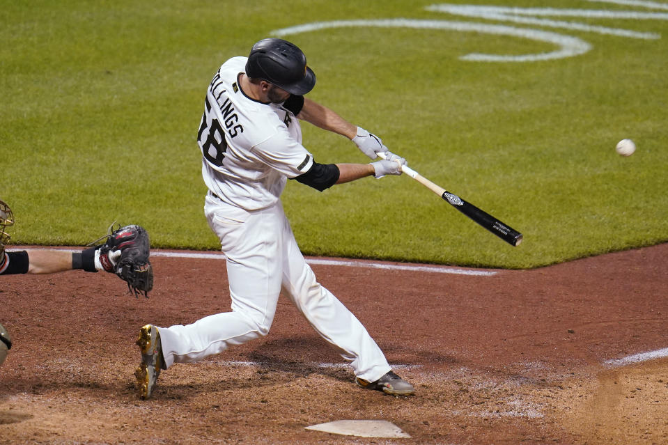 Pittsburgh Pirates' Jacob Stallings hits a two-run home run off San Francisco Giants relief pitcher Jake McGee during the ninth inning of a baseball game in Pittsburgh, Saturday, May 15, 2021. The Pirates won 8-6. (AP Photo/Gene J. Puskar)