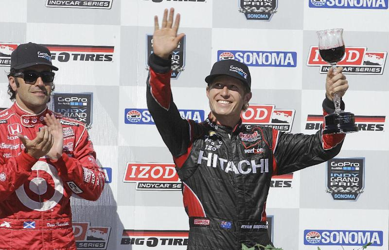 Ryan Briscoe of Australia, right, celebrates after winning the IndyCar Series auto race beside Dario Franchitti of Scotland Sunday, Aug. 26, 2012, in Sonoma, Calif. Franchitti finished in third place. (AP Photo/Ben Margot)