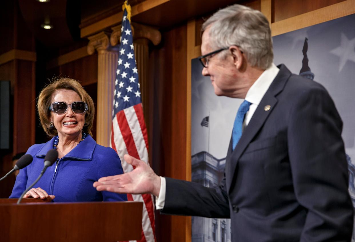 House Minority Leader Nancy Pelosi (D-Calif.) chuckles as she starts a news conference by donning dark glasses, a teasingly sympathetic gesture to Senate Minority Leader Harry Reid (D-Nev.) as he recovers from a serious injury to his right eye, suffered while exercising at his Nevada home during the holidays. (AP Photo/J. Scott Applewhite)
