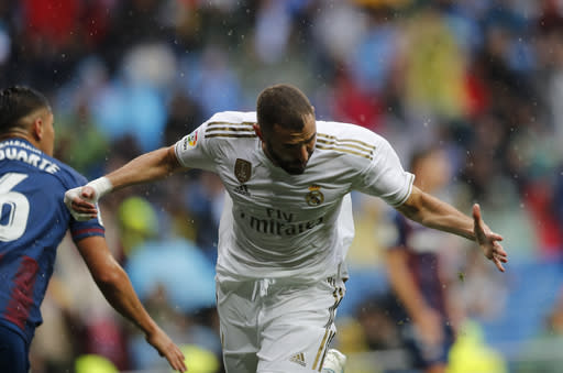 Real Madrid's Karim Benzema celebrates after scoring his side's first goal during the Spanish La Liga soccer match between Real Madrid and Levante at the Santiago Bernabeu stadium in Madrid, Spain, Saturday, Sept. 14, 2019. (AP Photo/Bernat Armangue)
