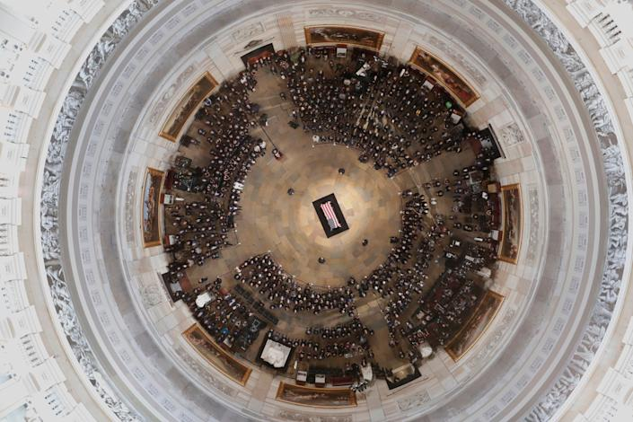 The casket of Sen. John McCain lies in state at the Capitol rotunda. (Photo: MORRY GASH/AFP/Getty Images)