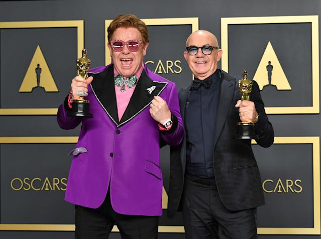 "Elton John and Bernie Taupin, winners of the Original Song award for ""(I'm Gonna) Love Me Again,"" <em>Rocketman</em>, pose in the press room during the 92nd Oscars on February 9, 2020 in Hollywood, Calif. (Photo: Amy Sussman/Getty Images)"