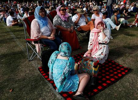 People attend a vigil for victims of the mosque shootings in Christchurch
