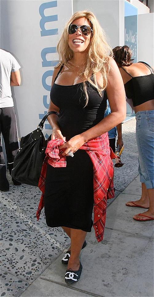 "Talk show host Wendy Williams' crispy coif is in desperate need of a VO5 hot oil treatment. Zodiac/Fapian/<a href=""http://www.splashnewsonline.com"" target=""new"">Splash News</a> - September 23, 2008"