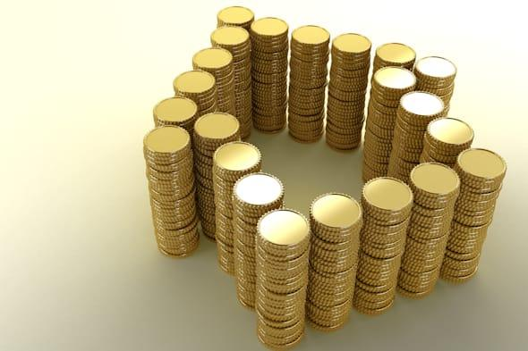 Coin stacks arranged to form a house shape. Concept image about rising house prices and mortgage costs. Copy space on the left s