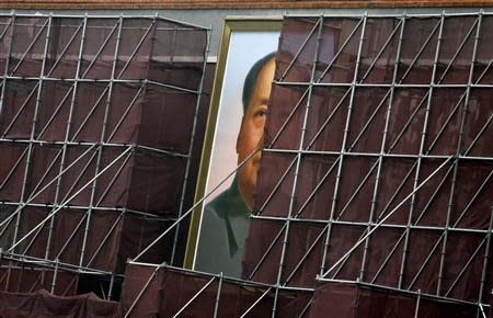A giant portrait of China's late leader Mao Zedong, which is surrounded by scaffolding during decoration work, is pictured at the Tiananmen Gate in Beijing in this August 28, 2013 file photo. REUTERS/Jason Lee/Files (CHINA - Tags: POLITICS BUSINESS)