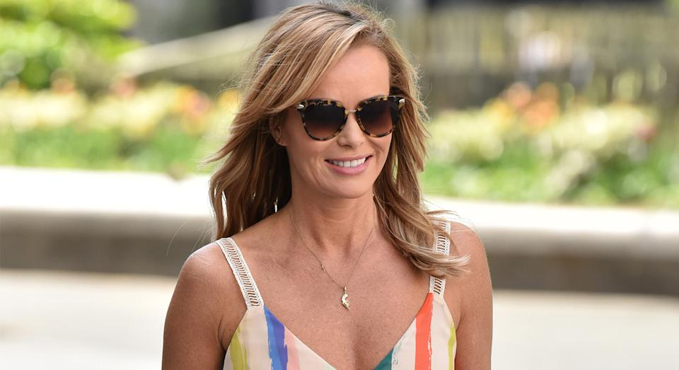 Amanda Holden wears affordable denim bodycon dress fromMichelle Keegan's Very range to co-host Heart Breakfast radio show.  (Getty Images)