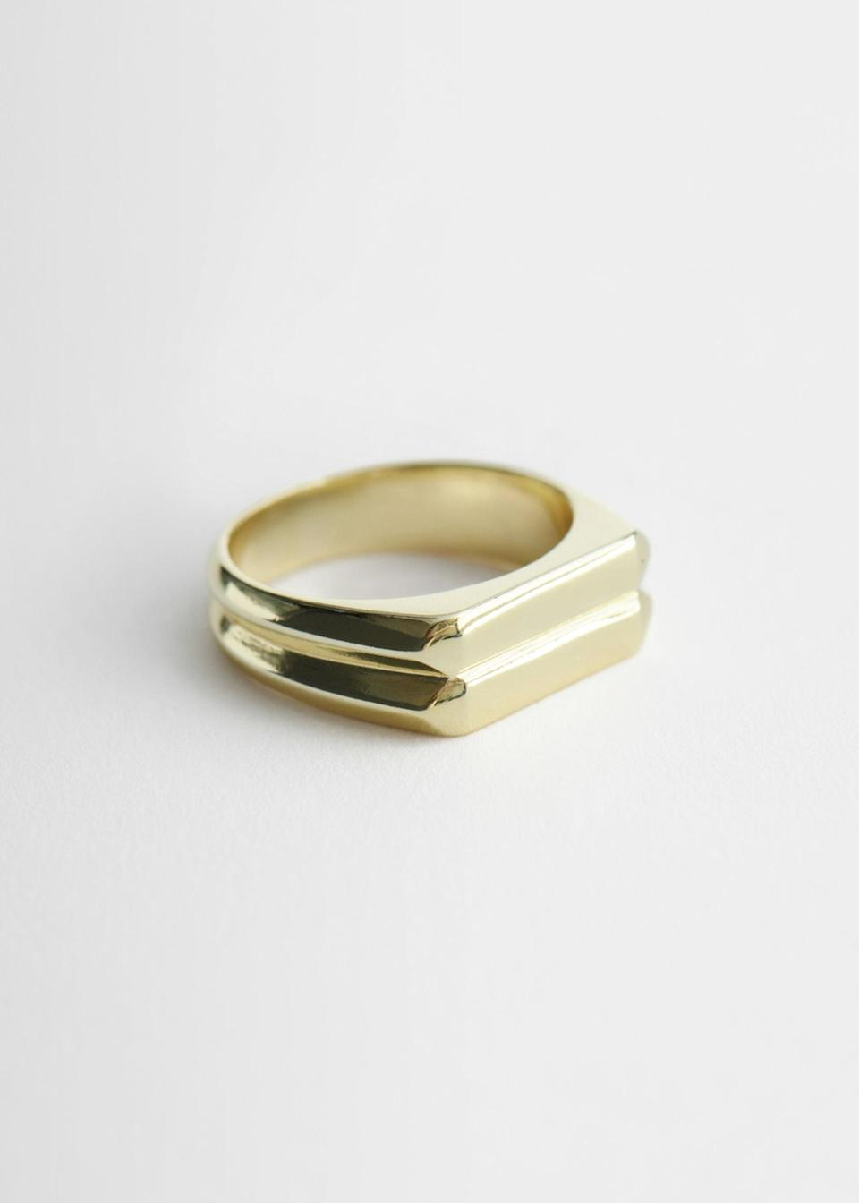 "<br><br><strong>& Other Stories</strong> Embossed Signet Ring, $, available at <a href=""https://go.skimresources.com/?id=30283X879131&url=https%3A%2F%2Fwww.stories.com%2Fen_usd%2Fjewellery%2Frings%2Fproduct.embossed-signet-ring-gold.0924423001.html"" rel=""nofollow noopener"" target=""_blank"" data-ylk=""slk:& Other Stories"" class=""link rapid-noclick-resp"">& Other Stories</a>"
