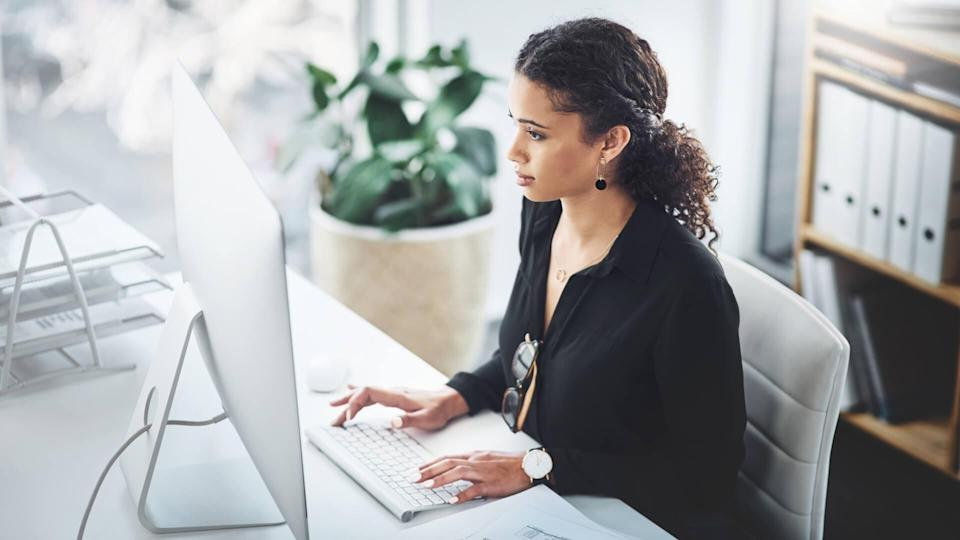 Shot of a young businesswoman working on a computer in an office.