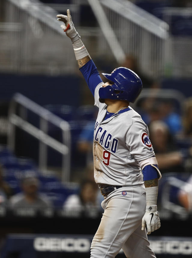 Chicago Cubs' Javier Baez celebrates as he passes home plate after he hit a solo home run during the eighth inning of the team's baseball game against the Miami Marlins on Wednesday, April 17, 2019, in Miami. (AP Photo/Brynn Anderson)