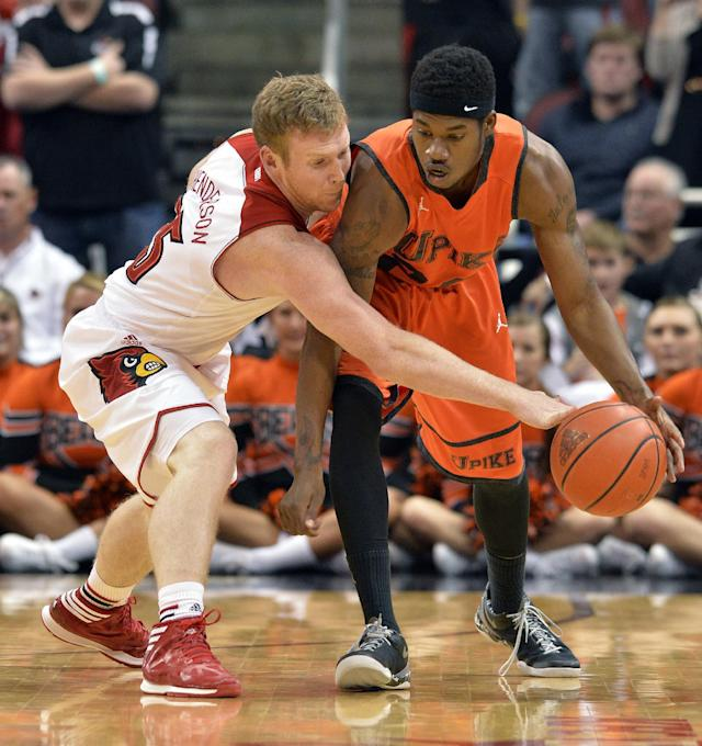 Louisville's Tim Henderson, left, tips the ball away from Pikeville's John Nunnally during the second half of an NCAA college basketball exhibition game, Wednesday, Nov. 6, 2013, in Louisville, Ky. Louisville defeated Pikeville 90-61. (AP Photo/Timothy D. Easley)