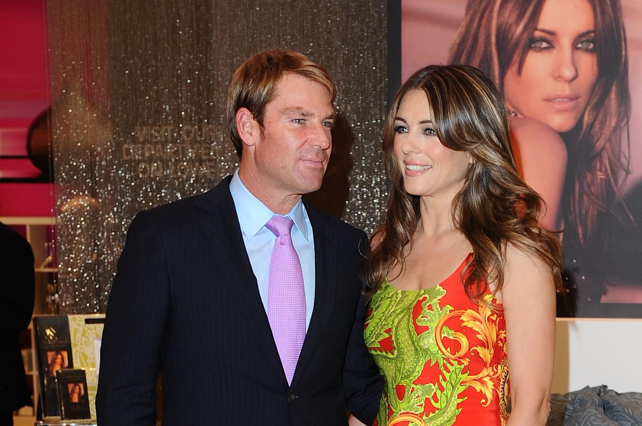 LONDON, ENGLAND - MAY 23:  Shane Warne and Elizabeth Hurley  launche her new bed linen collection at House of Fraser on May 23, 2012 in London, England.  (Photo by Ferdaus Shamim/WireImage)