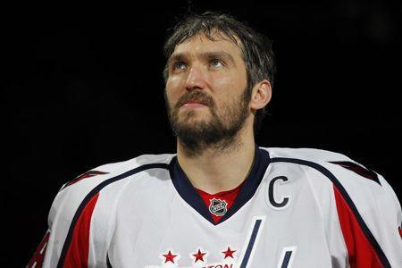 Feb 5, 2017; Washington, DC, USA; Washington Capitals left wing Alex Ovechkin (8) looks on during a ceremony honoring Ovechkin's 1,000th NHL career point prior to the Capitals' game against the Los Angeles Kings at Verizon Center. Mandatory Credit: Geoff Burke-USA TODAY Sports