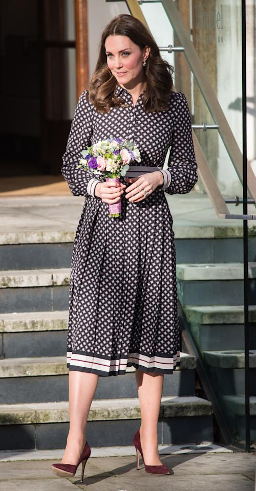 <p>Kate visited London's Foundling Museum wearing a printed shirt dress by New York-based designer Kate Spade. She topped off the monochrome look with suede burgundy heels and a matching clutch. <i>[Photo: Getty]</i> </p>
