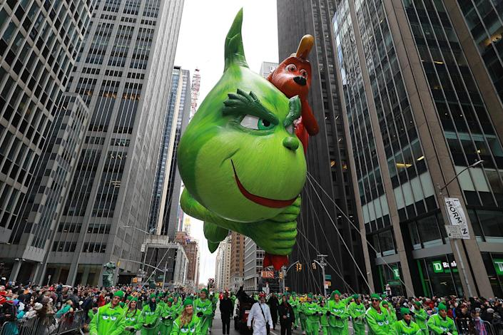 The deliciously wicked Grinch and his loyal dog, Max, are stealing Christmas and the spotlight on the Parade route this Thanksgiving with a sack full of toys and a subversive smile. (Photo: Gordon Donovan/Yahoo News)