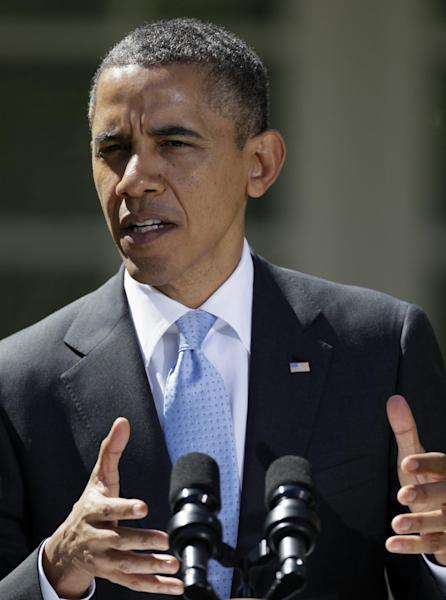 President Barack Obama gestures during a joint news conference with Canadian Prime Minister Stephen Harper, and Mexican President Felipe Calderon, not seen, Monday, April 2, 2012, in the Rose Garden of the White House in Washington. (AP Photo/Carolyn Kaster)