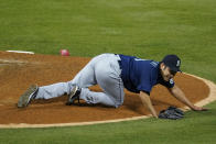 Seattle Mariners starting pitcher Yusei Kikuchi (18) reacts after being hit by a ball hit by Los Angeles Angels' David Fletcher during the fifth inning of a baseball game Saturday, June 5, 2021, in Anaheim, Calif. (AP Photo/Ashley Landis)
