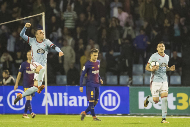RC Celta's Iago Aspas celebrates after scoring the second goal, during a Spanish La Liga soccer match between RC Celta and Barcelona at the Balaidos stadium in Vigo, Spain, Tuesday, April 17, 2018. (AP Photo/Lalo R. Villar)