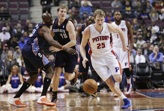 Detroit Pistons forward Kyle Singler (25) steals the ball from Charlotte Bobcats center Cody Zeller (40) during the first quarter of an NBA basketball game in Auburn Hills, Mich., Tuesday, Feb. 18, 2014. (AP Photo/Carlos Osorio)