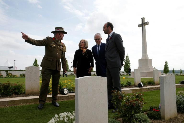 Australian Colonel Scott Clingan escorts French Prime Minister Edouard Philippe (right) and Australian Prime Minister Malcolm Turnbull (second right) and his wife Lucy through the military cemetery in Villers-Bretonneux