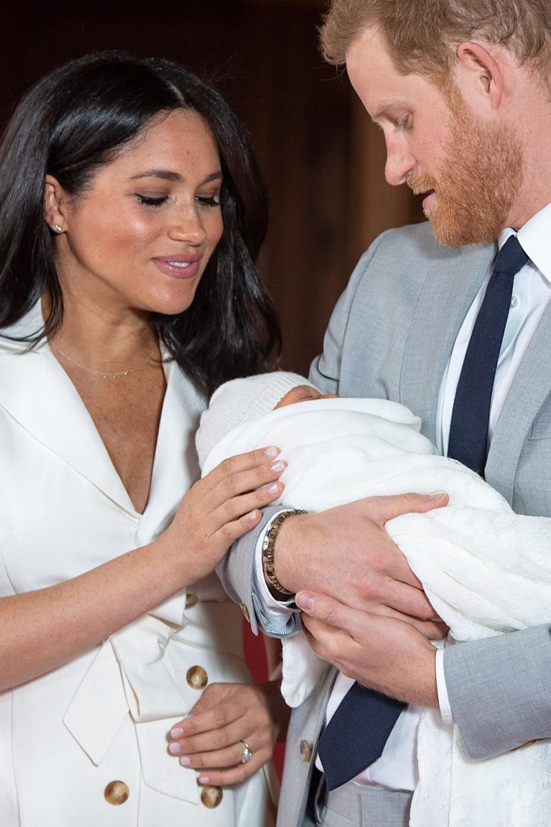 Britain's Prince Harry, Duke of Sussex (R), and his wife Meghan, Duchess of Sussex, pose for a photo with their newborn baby son, Archie Harrison Mountbatten-Windsor, in St George's Hall at Windsor Castle in Windsor, west of London on May 8, 2019. (Photo by Dominic Lipinski / POOL / AFP) (Photo credit should read DOMINIC LIPINSKI/AFP/Getty Images)