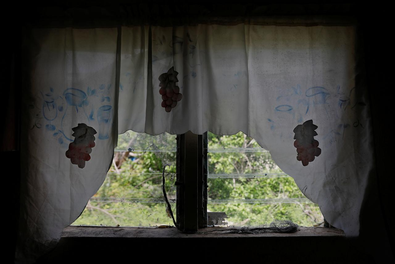 <p>Curtains are seen hanging from a home at Codrington on the island of Barbuda just after a month after Hurricane Irma struck the Caribbean islands of Antigua and Barbuda, October 7, 2017. REUTERS/Shannon Stapleton </p>